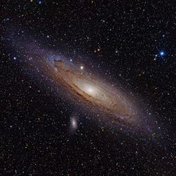 """Andromeda Galaxy (with h-alpha)"" by Adam Evans - M31, the Andromeda Galaxy (now with h-alpha)Uploaded by NotFromUtrecht. Licensed under CC BY 2.0 via Commons - https://commons.wikimedia.org/wiki/File:Andromeda_Galaxy_(with_h-alpha).jpg#/media/File:Andromeda_Galaxy_(with_h-alpha).jpg"
